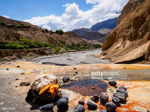 Mineral spring bubbles from rock in Mustang Nepal
