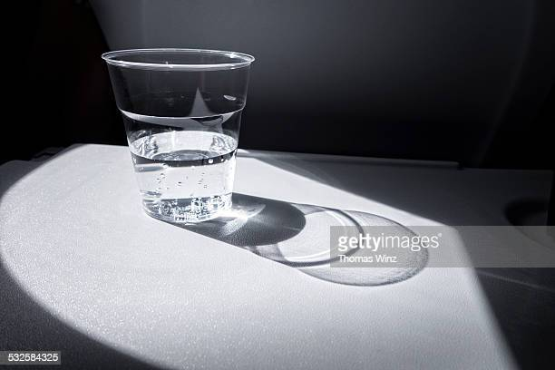 Mineral water at an airplane seat