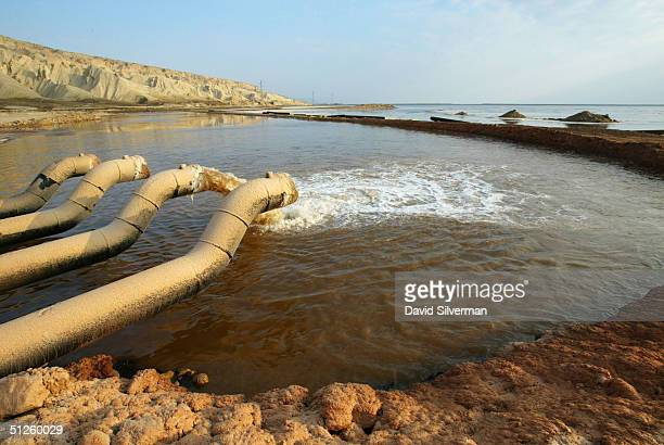 Mineralrich water is pumped into a Dead Sea Works evaporation pool at the industrial giant's potash recovery plant on the shores of the Dead Sea...