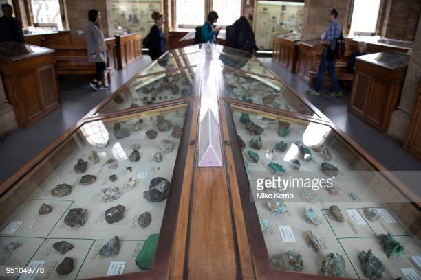 Minerals collection in glass cases at the Natural History Museum in London England United Kingdom The museum exhibits a vast range of specimens from...
