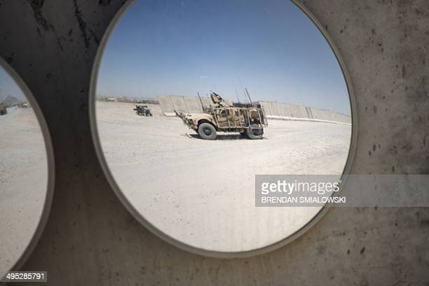 A mineresistant armoured vehicle is seen at Forward Operating Base Pasab in Afghanistan's Kandahar province on June 2 2014 US forces will complete...