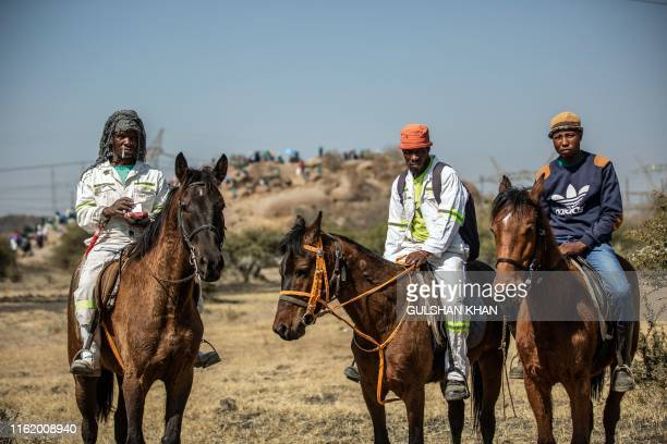 Miners Afrika Kabola Lenyatsa Mohawu and Ramapipi Pakese ride their horses, which they use as a means of transport in the area, to Wonderkop in...