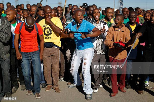Miners and supporters of the Marikana mining community march near the Lonmin Platinum Mine to commiserate the one year anniversary of the massacre at...