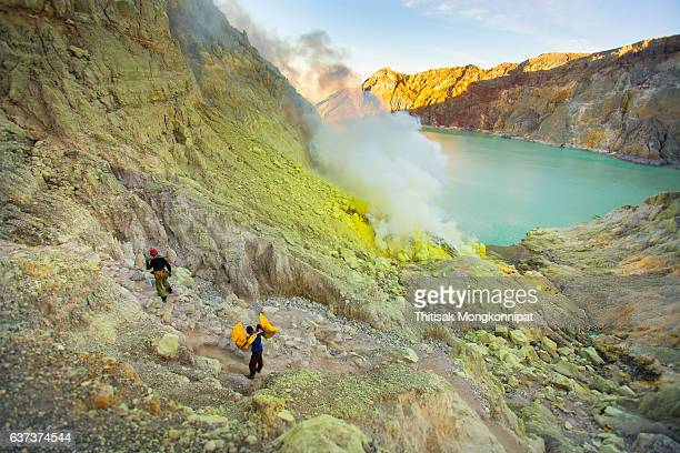 Miners are carrying sulfur from Ijen Volcano
