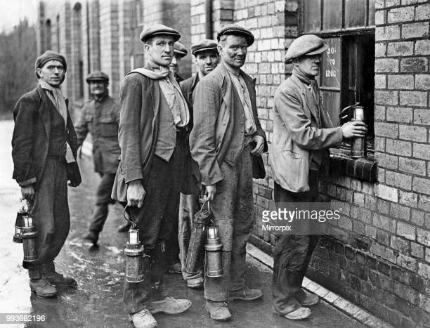 Miners at the Cannock Wood Pit handing in their Davy Lamps and lanterns at the end of their shift May 8th 1939