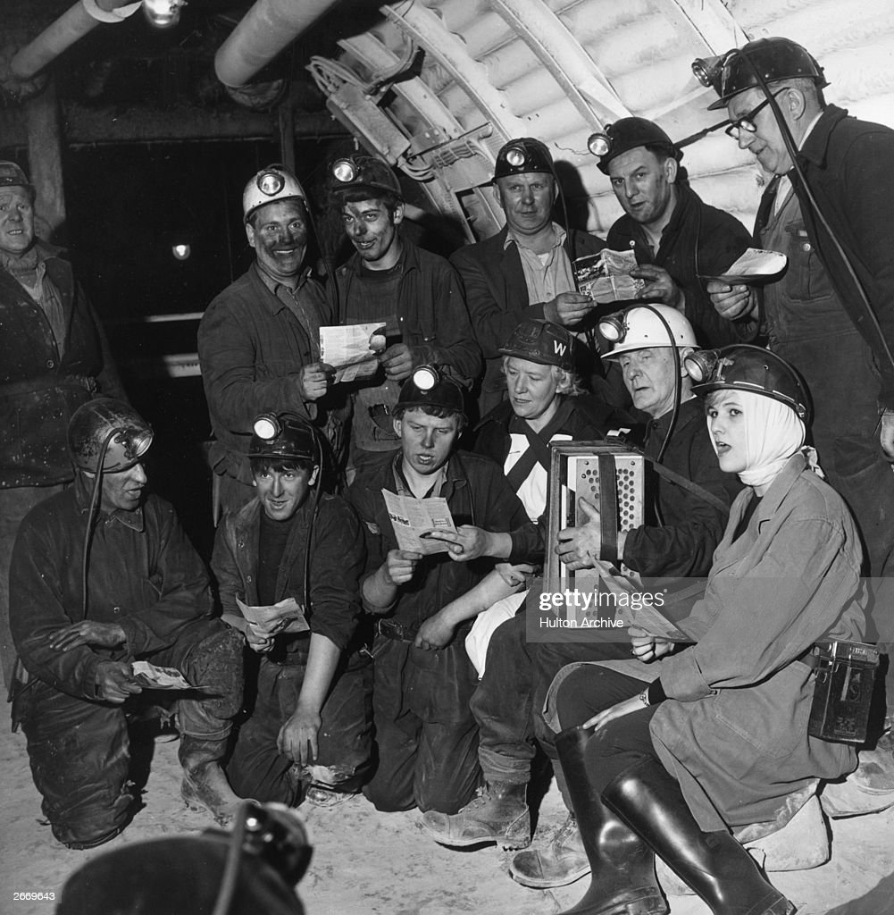 Miners at Wath Main Colliery in Yorkshire singing Christmas carols 550 ft underground with women nurses from the colliery first aid post.