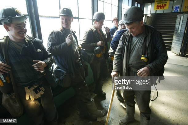 Miners chat and joke before descending for a shift underground at the Wieczorek coal mine April 14 2004 in Katowice Poland Poland will be the largest...