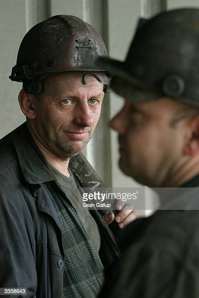 Miners chat before descending for a shift underground at the Wieczorek coal mine April 14 2004 in Katowice Poland Poland will be the largest producer...