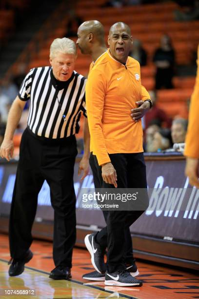 Miners coach Rodney Terry is restrained by assistant coach Lamont Smith following a technical foul during a college basketball game between Norfolk...