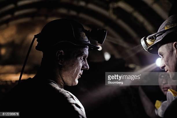 Miners converse as they work an underground coal seam in the Piniowek coal mine operated by Jastrzebska Spolka Weglowa SA in Pawlowice Poland on...