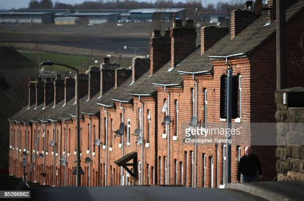 Miners cottages in the village of Treeton overlook the land where the former Orgreave coking plant was situated 25 years on from the start of the...