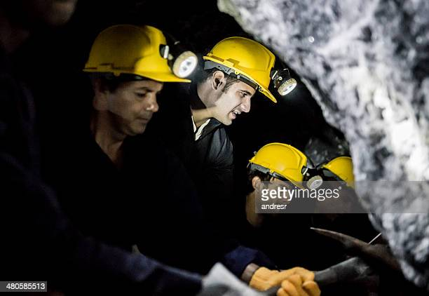 Miners digging a tunnel