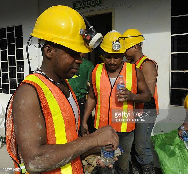 Miners drink some water as they work in the rescue operation for two miners trapped in the Casa Negra mine in Portovelo Ecuador on October 20 2010...
