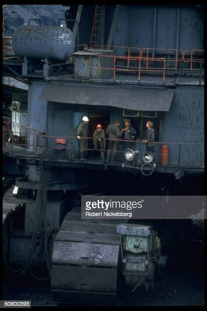 Miners dwarfed by vastness of machinery at 1 of largest open pit coal mines in world extracting 200000 tons day in Central Steppes region Ekibastuz