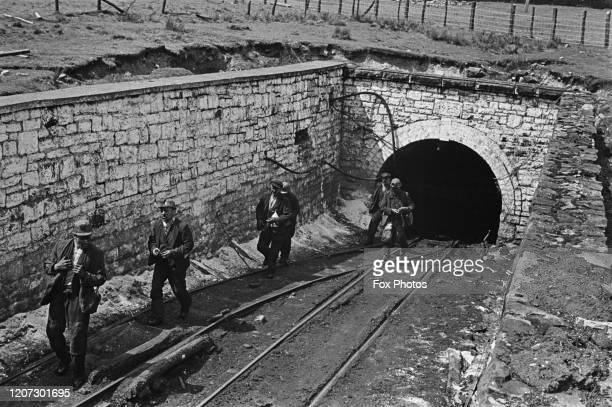 Miners emerging from a tunnel at Blaenavon Colliery in Blaenavon Torfaen Wales circa 1940