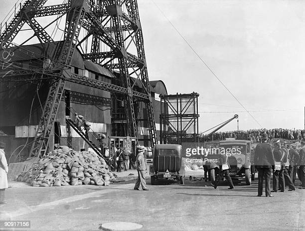 Miners enter the pithead at Gresford Colliery near Wrexham in Wales with bags of cement to seal off the mine where a fire is still burning after an...