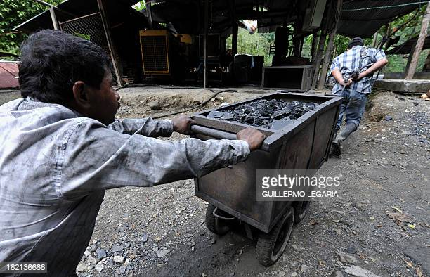 Miners extract stones and earth in a mine cart at the emerald mine 'La Espanola' close to the hamlet of Muzo department of Boyaca Colombia on January...