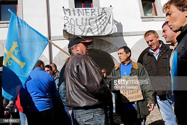 Miners, family members and locals gather on October 29, 2013 in Pola de Gordon northwestern Spain in memory of six miners who died asphyxiated...
