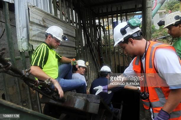 Miners from a rescue team go into the mine to work in a 150metredeep shaft of Casa Negra mine in Portovelo Ecuador on October 18 2010 Rescue crews...