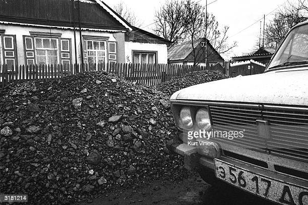 A miner's front yard near Shatorysk is covered in coal awaiting purchase from passerbys February 24 2002 in the Ukraine The miner and his son must...