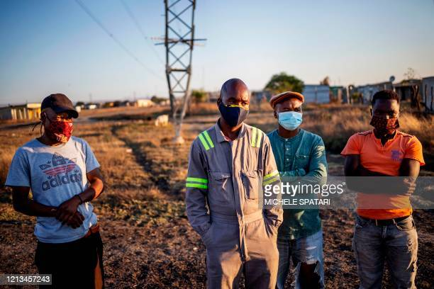 Miners gather in the Wonderkop settlement in Marikana near Rustenburg on May 15 2020 The mines are a critical cog in South Africa's already...