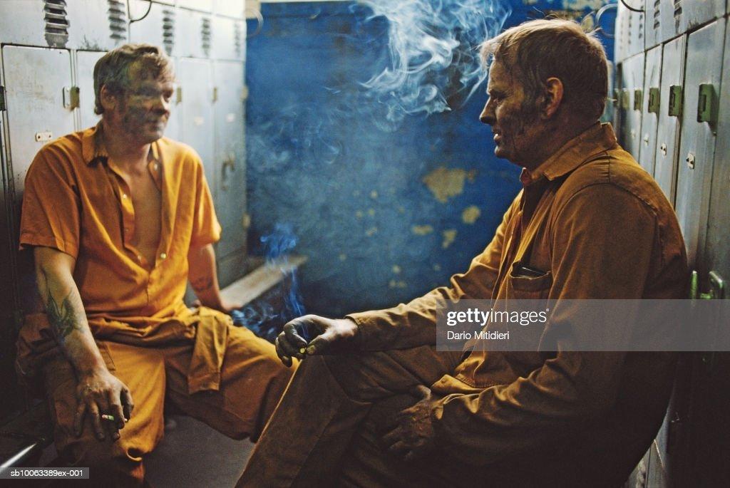 Miners having cigarette break in locker room