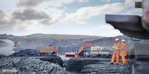 miners in discussion in surface coal mine - coal mining stock photos and pictures