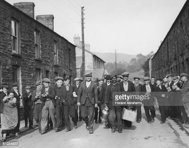 Miners in the streets of Bedlinog in south Wales after a fiveday protest at the bottom of a mine 17th October 1935 Several of the striking miners...