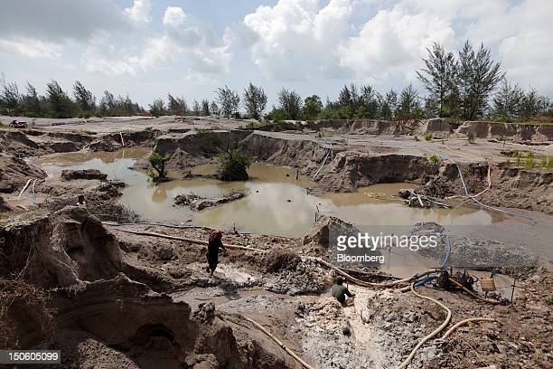 Miners labor in a tinmining pit in Sungai Liat Bangka Island Indonesia on Saturday July 28 2012 In recent years about onethird of all the tin mined...