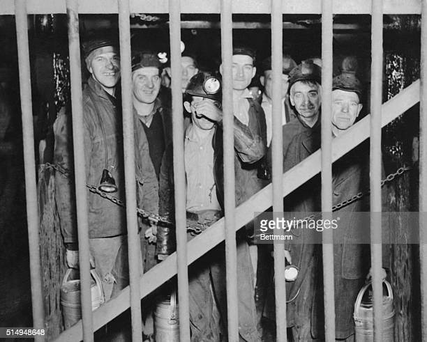 Miners of the day shift of the Red Lion Mine of the HC Frick Coke Company in Fayette County are shown behind the bars of their elevator as they went...