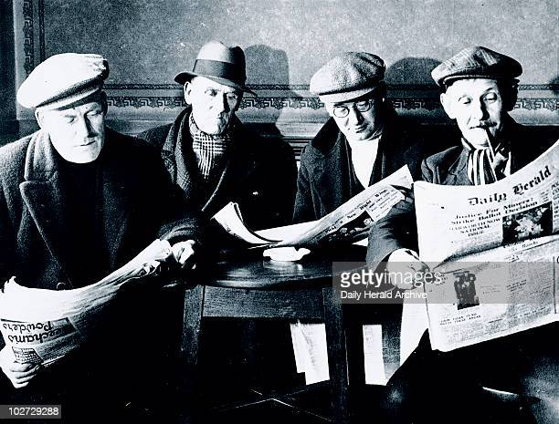 Miners on strike Harworth colliery Nottinghamshire 1937 Photograph showing miners on a stayinstrike reading the Daily Herald newspaper Harworth in...