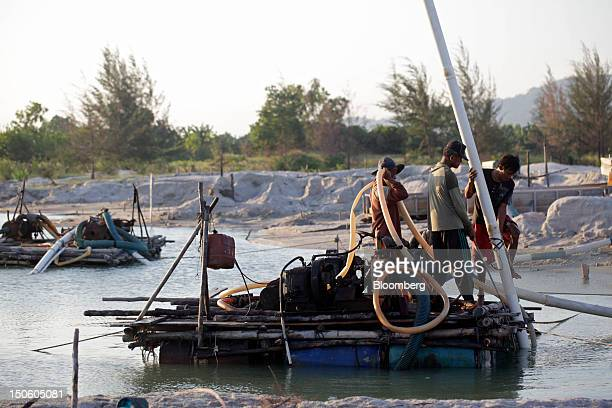 Miners operate a bamboo raft used to dredge for tin ore in Sungai Liat Bangka Island Indonesia on Friday July 27 2012 In recent years about onethird...
