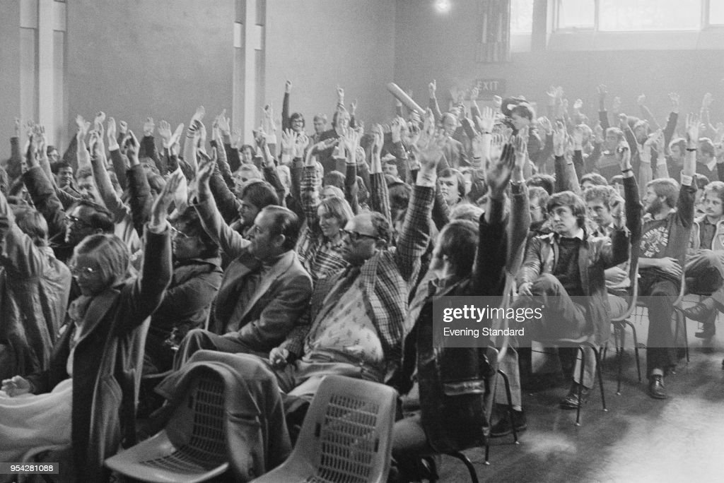 Miners raising their arms to vote at an assembly, UK, 13th October 1977.