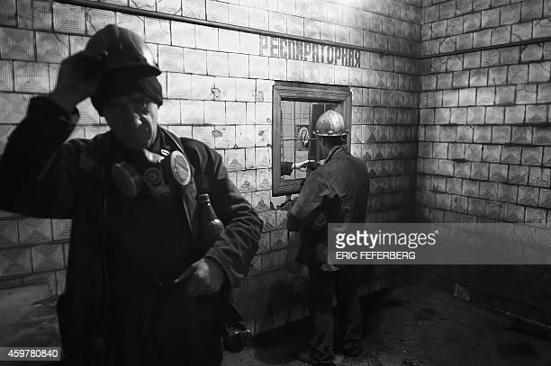 Miners receive equipment as they go on their duty at the Kalinina coal mine in the eastern Ukrainian city of Donetsk controlled by proRussian rebels...