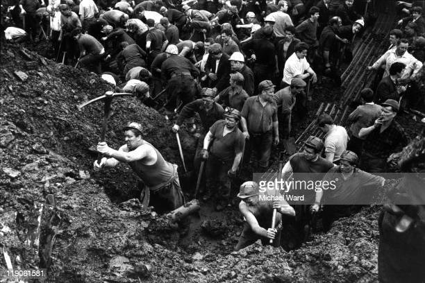 Miners searching for their children in the slag heap that slipped down the mountainside to engulf their village school Aberfan