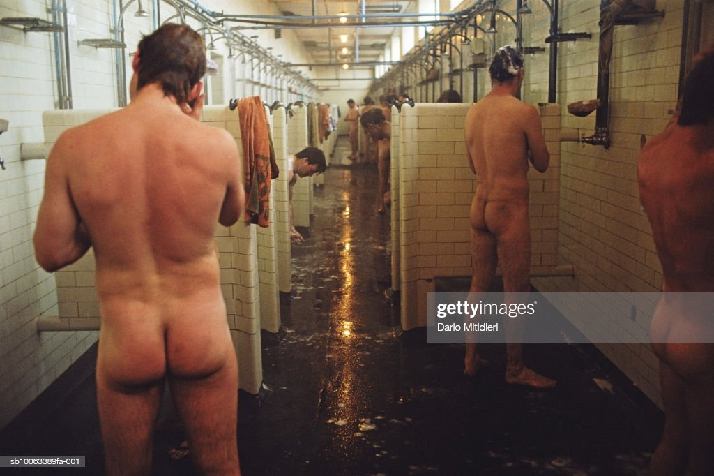 Miners showering after shift, rear view