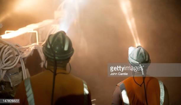 Miners sink restraining bolts into the roof of a freshlyexcavated mineshaft to stop the roof collapsing during a shift at Boulby mine on May 21 2012...