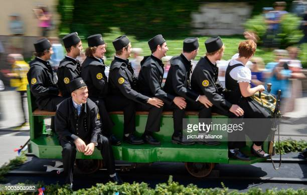 Miners sit on a mine train attached to a horsedrawn carriage during a festival procession in Berchtesgaden Germany 5 June 2017 The Bavarian town is...
