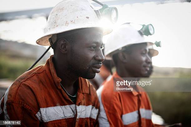 Miners sits and wait above ground before returning to the underground digging face at the Gara gold mine operated by Randgold Resources Ltd in Loulo...