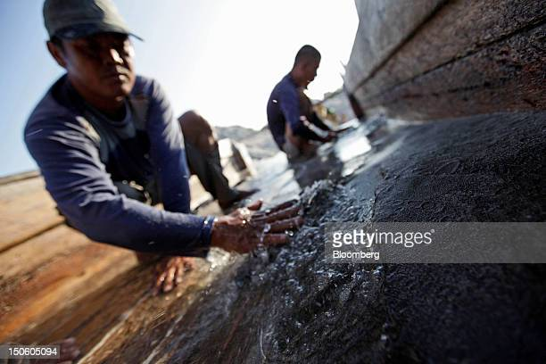 Miners sluice for tin ore at a mine in Sungai Liat Bangka Island Indonesia on Friday July 27 2012 In recent years about onethird of all the tin mined...