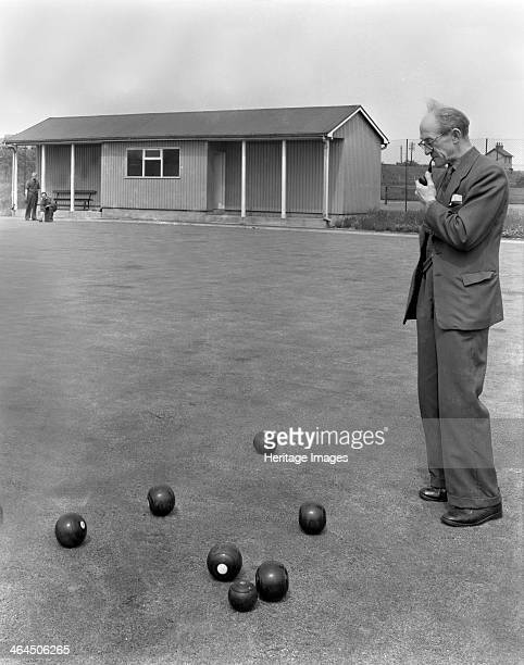 Miners' social club bowling green Featherstone West Yorkshire 1959 An ex miner looks on as a game of bowels is being played at Fetherstone in this...