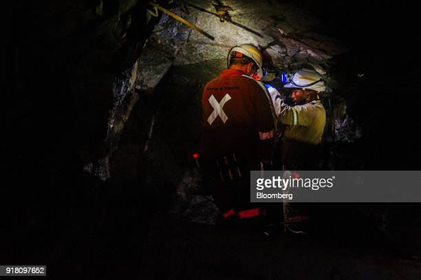 Miners stand inside a mine shaft at the Northam Platinum Ltd Booysendal platinum mine located outside the town of Lydenburg in Mpumalanga South...