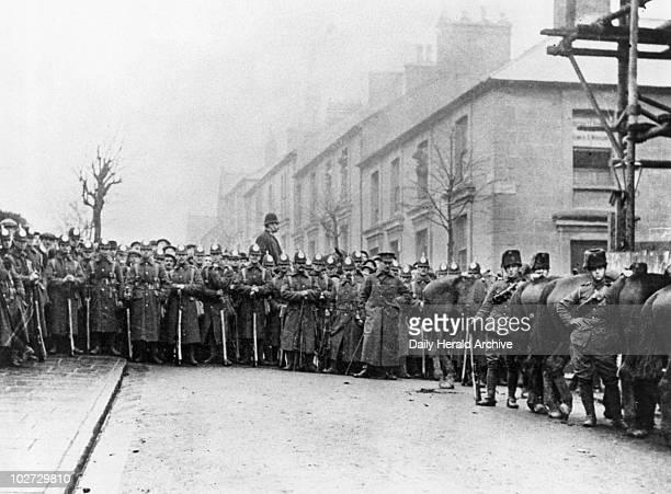 Miner's Strike, 1910. Devon and Hussar Regiment outside Pontypridd police station.