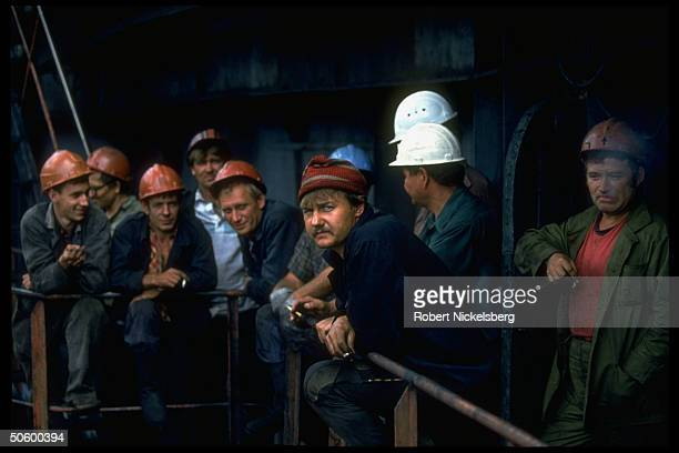 Miners taking cigarette smoking break at 1 of largest open pit coal mines in world extracting 200000 tons day in Central Steppes region Ekibastuz