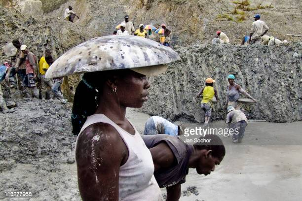 Miners use helmets to protect their heads during the day in the mine on May 26 2004 in Chocó This place where many women work illegally for a living...