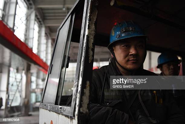 Miners wait on a bus before being driven to a coal mine near Datong in China's northern Shanxi province on November 19 2015 China will not improve on...