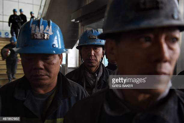 Miners wait to enter a coal mine near Datong in China's northern Shanxi province on November 19 2015 China will not improve on its pledges to control...