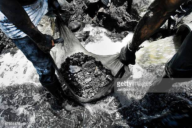 Miners wash the emerald containing mud in the mine of Muzo on April 21 2006 in Muzo Colombia Despite of a persisting civil war conflict Colombia...