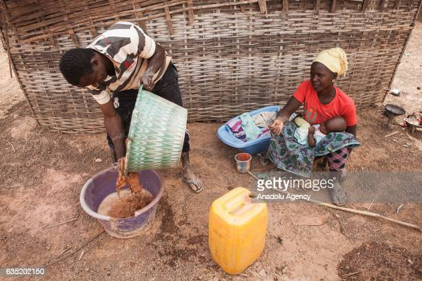 Miners work at a gold mine in Tomboronkoto Senegal on February 11 2017 After the sand dries out removing as much water as possible and mixing it with...