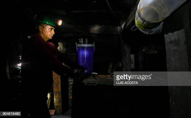 Miners work at an emerald mine in the municipality of Muzo known as the 'emerald capital of the world' in the Colombian department of Boyaca on...